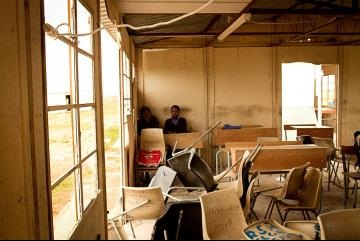 Chairs are scattered and turned over everywhere in a school in South Africa.