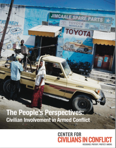 Report cover shows some individuals standing in front of a car speaking. They stand inffront of a Toyota ad and a shop front that says it has spare car parts.