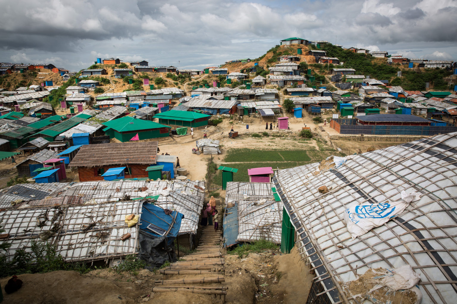 Cox's Bazar Bangladesh aerial view shows a refugee camp with dilapidated houses.